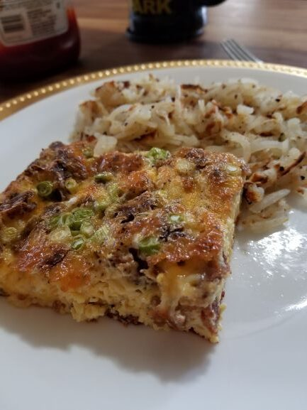 Bacon Cheese Frittata plated with hash brown potatoes