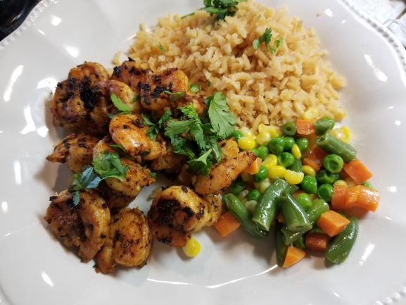 Grilled Chipotle Shrimp plated with Restaurant Style Mexican rice and mixed veggies