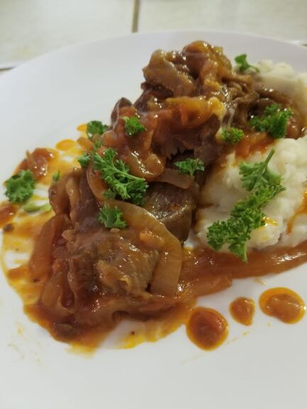 Smothered Swiss Steak with mashed potatoes and gravy